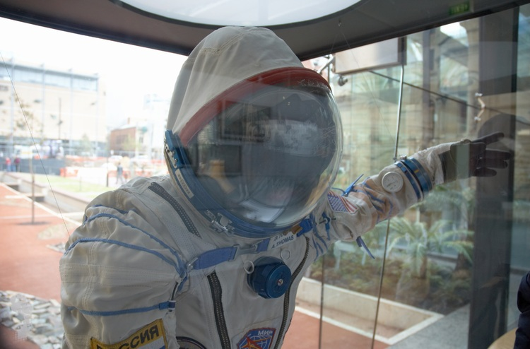 spacesuit in a glass display case