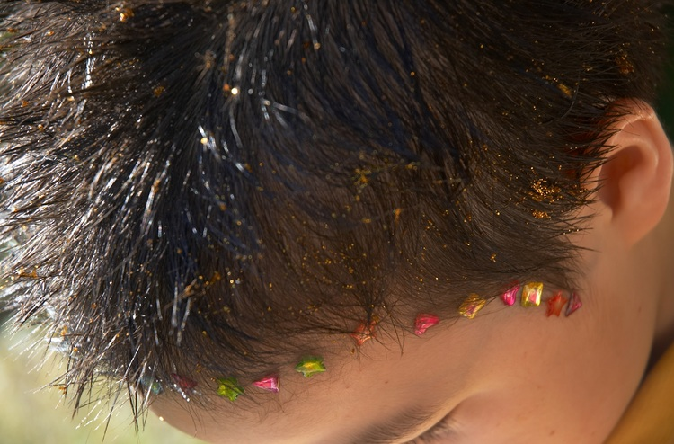 Closeup of michael's hair done up with glitter and sticke