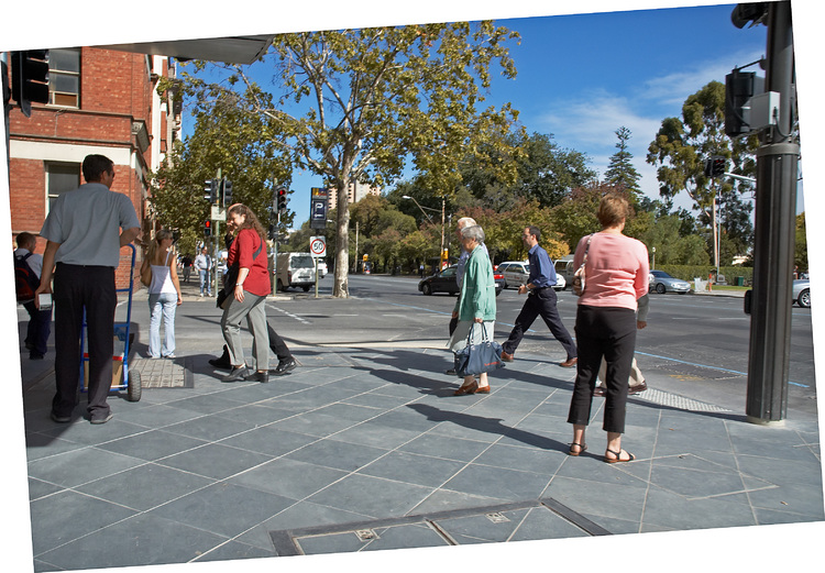 People at the corner of Gawler Place and North Terrace