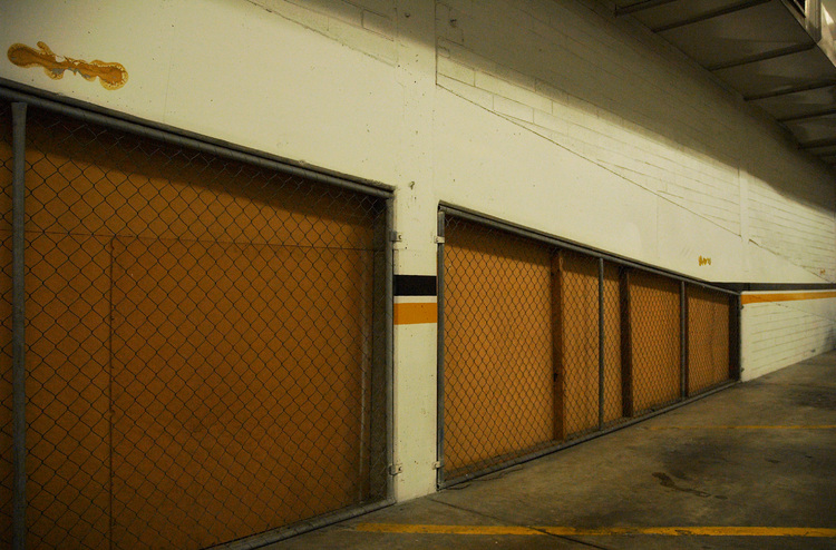 A wall and mesh fence in a car-park