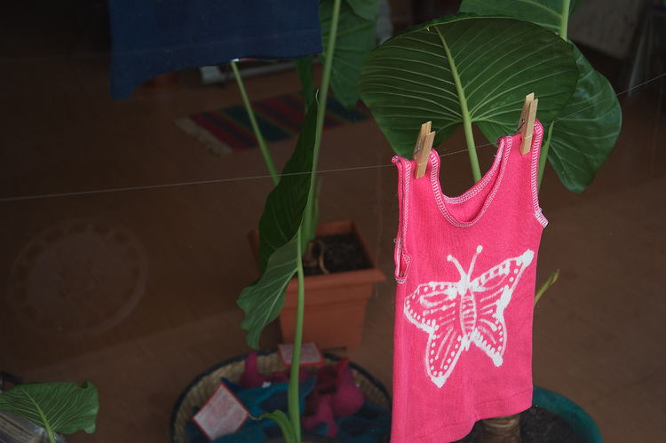 A pink singlet hanging in a shop window