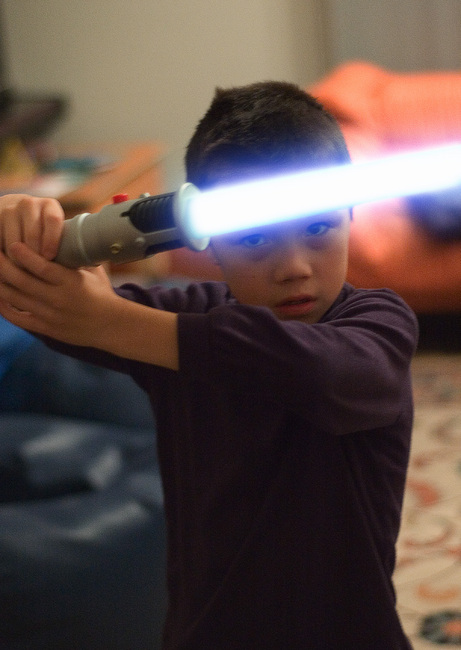 Michael poses with his light sabre (light saber)
