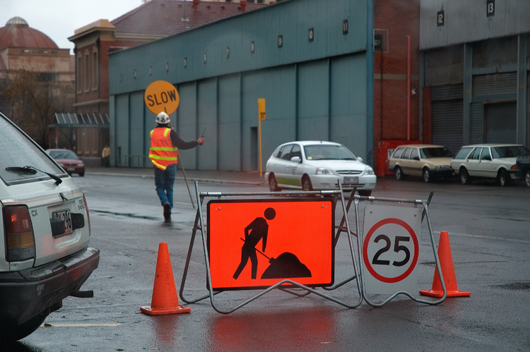 A roadworker and his signs