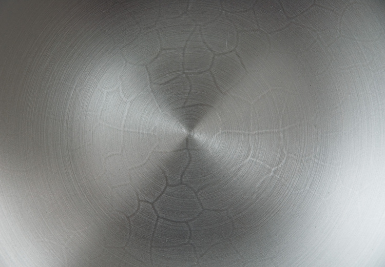 The base of a pristine wok, with a crazed pattern showing through