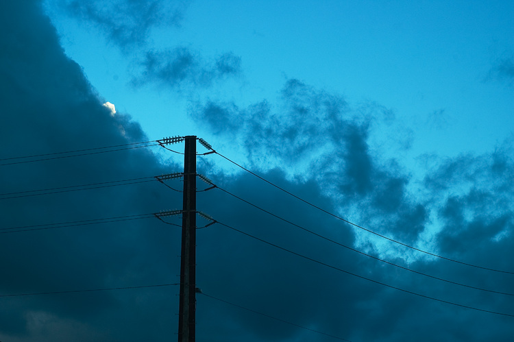 Power lines against an early evening sky