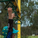 Michael hanging from playground equipment