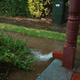 Water gushing from a downpipe