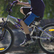 Michael riding his bike, with his head cropped from the picture